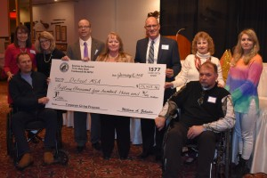 The January 8, 2018 check presentation from the Bavarian Inn Company Giving Program to the Defeat MSA Foundation (l-r): Amy Zehnder Grossi (General Manager), Dave and Brenda Sievert (Local MSA Family), Phillip Fortier (Director of Defeat MSA), Kathy Walstad and Jim Dohrmann (Giving Program Co-Chairs), Kim, Dan and Makayla Moncman (Local MSA Family).