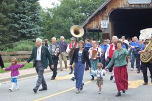 Bavarian Inn family members lead the Annual Labor Day Bridge Walk in Frankenmuth.